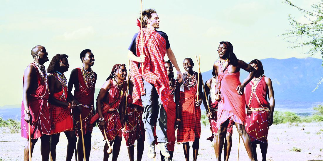 Kenya citizens entertaining a tourist